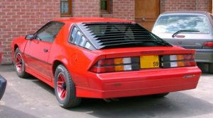 The louvered rear window.  A must have on any 80s sports car.